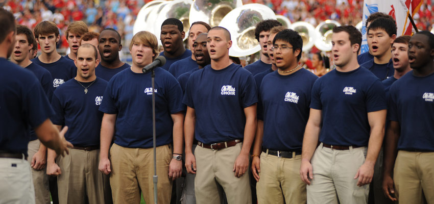 Men's Glee performs the National Anthem at an Ole Miss football game.