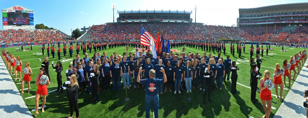 Concert Singers perform the National Anthem at an Ole Miss football game.